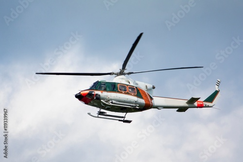 Tuinposter Helicopter White-orange helicopter is flying