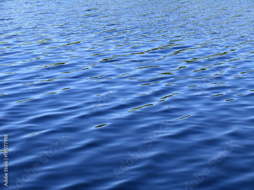 Fotografía  Waves on surface of water. Deep blue color