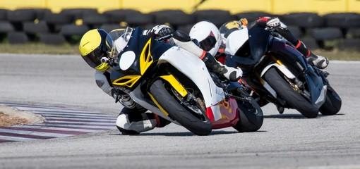 Mototbikes Racing on Track