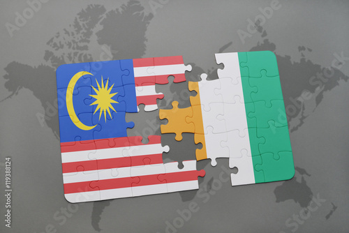 Photo  puzzle with the national flag of malaysia and cote divoire on a world map background