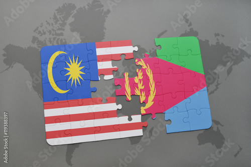 Photo  puzzle with the national flag of malaysia and eritrea on a world map background