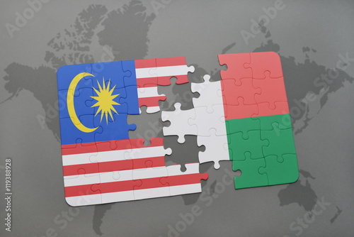 Photo  puzzle with the national flag of malaysia and madagascar on a world map background