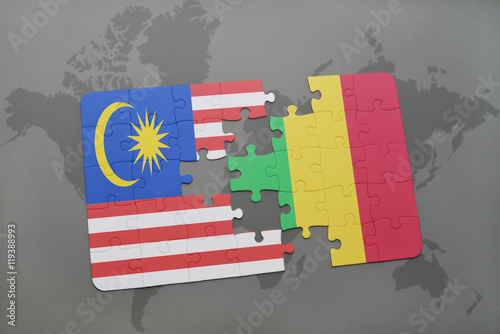 Photo  puzzle with the national flag of malaysia and mali on a world map background