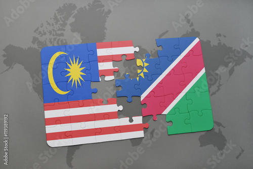 Photo  puzzle with the national flag of malaysia and namibia on a world map background