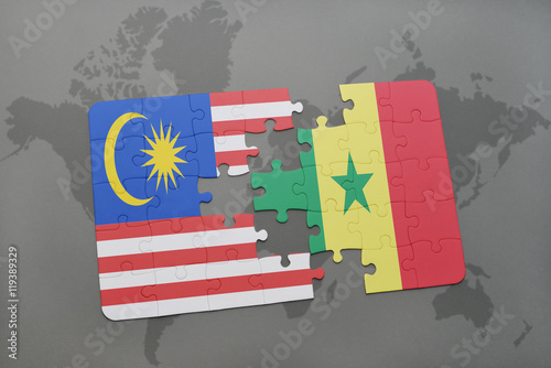 Photo  puzzle with the national flag of malaysia and senegal on a world map background