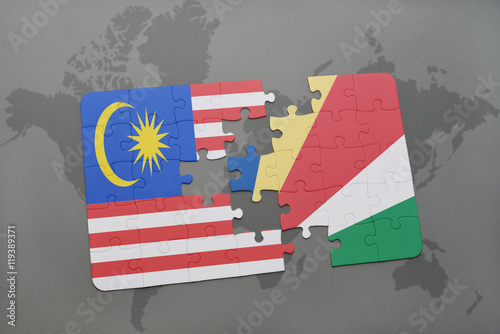 Photo  puzzle with the national flag of malaysia and seychelles on a world map background