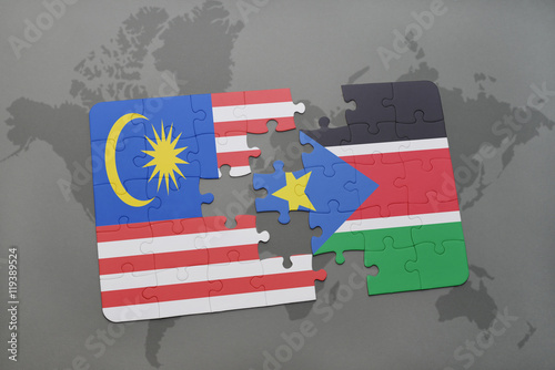Photo  puzzle with the national flag of malaysia and south sudan on a world map background