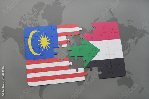 Photo  puzzle with the national flag of malaysia and sudan on a world map background