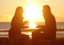 Couple Talking At Sunset On The Beach