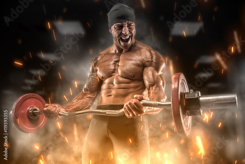 Angry athlete trains in the gym Fototapeta