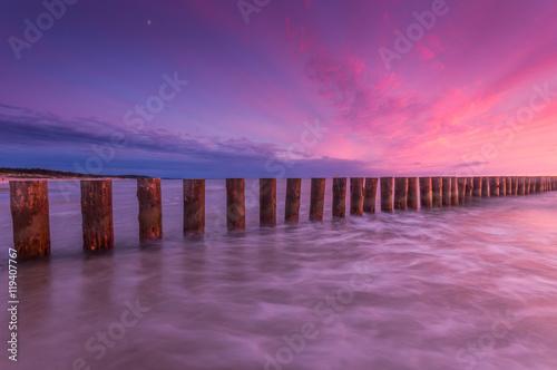 Foto op Aluminium Snoeien Wooden breakwater - Baltic seascape at sunset, Poland