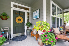 Cozy Entrance Porch With Flower Pots And Seating Arrangement