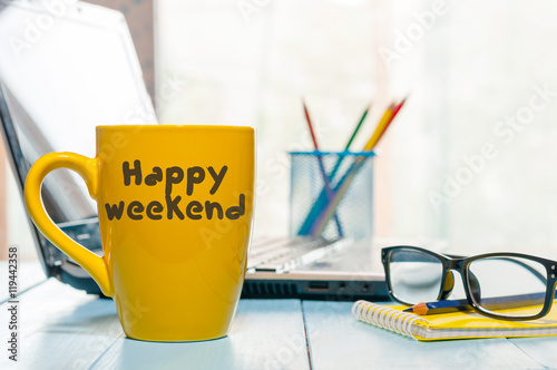 Láminas  Happy Weekend coffee cup at office background or student workplace