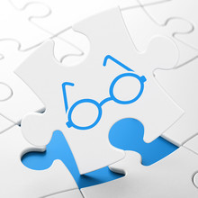 Education Concept: Glasses On Puzzle Background