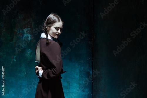 Canvastavla Portrait of a young girl in school uniform as killer woman