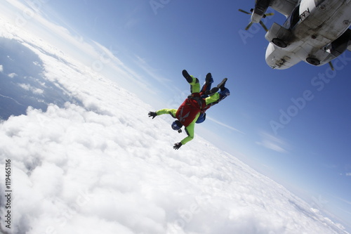 Fotografie, Obraz  Two skydivers in tandem jumping from the plane.