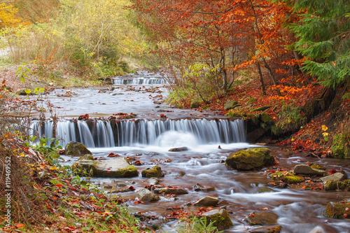 Fototapeta beautiful waterfall in forest, autumn landscape