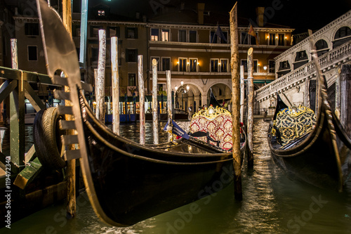 The big canal gondola and boats in romantic Venice in Italy by night