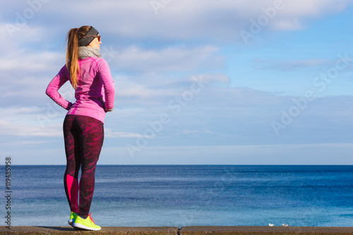 Fotobehang Ontspanning Woman resting after doing sports outdoors on cold day