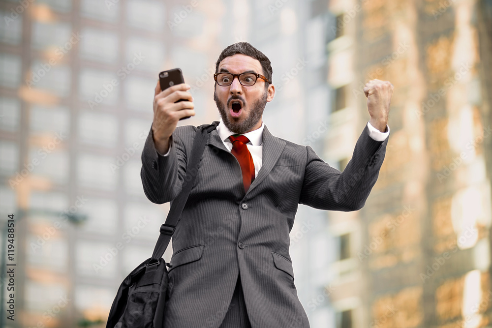 Fototapeta Ecstatic happy executive sales businessman cheering excited in celebration after good news