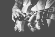Closeup Male Musician Hands Pl...