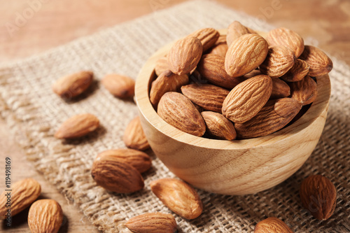 Almond snack fruit in wooden bowl Canvas-taulu