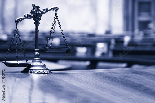 Photo Decorative Scales of Justice in the Courtroom.