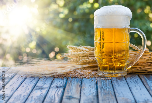 beer, ears and corn barley on an old table Wallpaper Mural
