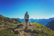 Woman Hiking In The Allgau Alps, Germany