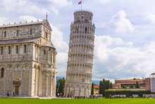 Cathedral And The Leaning Tower Of Pisa At Sunny Day, Italy.