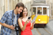 Couple Of Tourists Consulting Guide Online