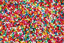 Colorful Sugar Sprinkles Background.