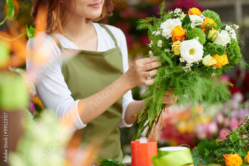 Cropped image of florist making bouquet for client