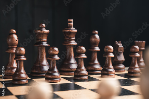 chess pieces on chessboard Poster