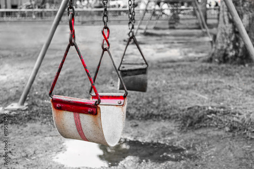 Close Up Old Red Swing At Playground Selective Red Color Effect