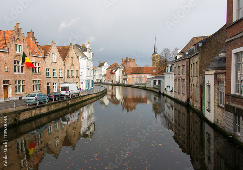 In de dag Brugge The view of the canals and the historic quarter of Bruges cloudy autumn morning. Bruges is one of the oldest and most beautiful cities in Europe