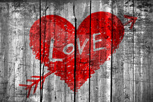 """Drawing Of A Heart With Word """"Love"""" On Grunge Wooden Wall"""