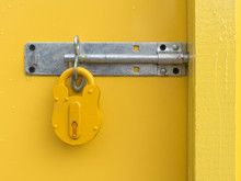 Yellow Padlock On Yellow Door
