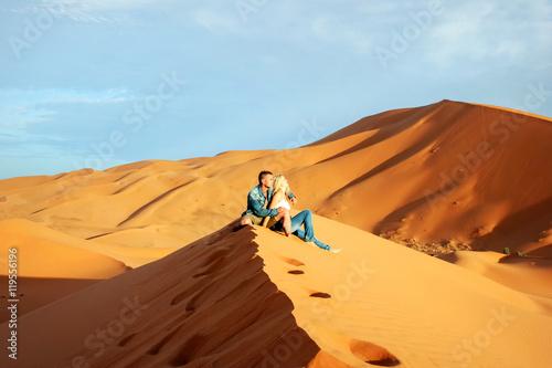 Loving couple in the Sahara Desert in Morocco