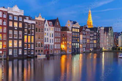 Ingelijste posters Amsterdam Amsterdam canal with typical houses and church during twilight blue hour, Holland, Netherlands
