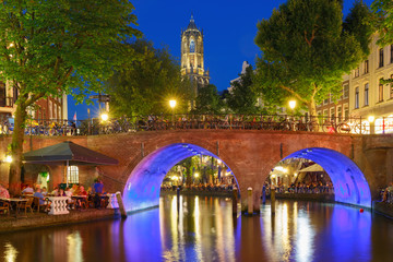 Dom Tower and canal in the night colorful illuminations in the blue hour, Utrecht, Netherlands