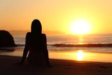 Woman Silhouette Watching Sun At Sunset