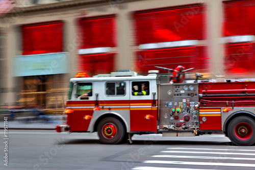 fire trucks and firefighters brigade in the city Canvas Print