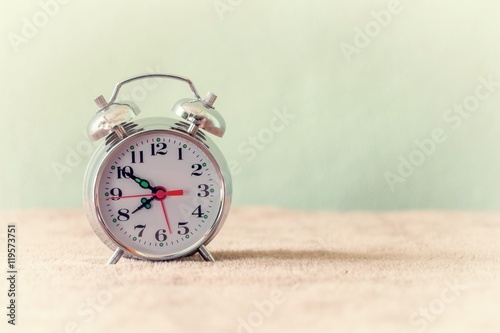 Vintage background with retro alarm clock on table Wallpaper Mural