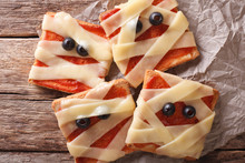 Halloween Food: Sandwiches Mummy Close Up. Horizontal Top View