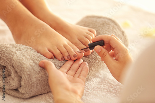 Woman having pedicure at salon