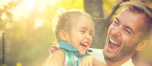 Photo sur Toile Attraction parc Happy joyful young father with his little daughter