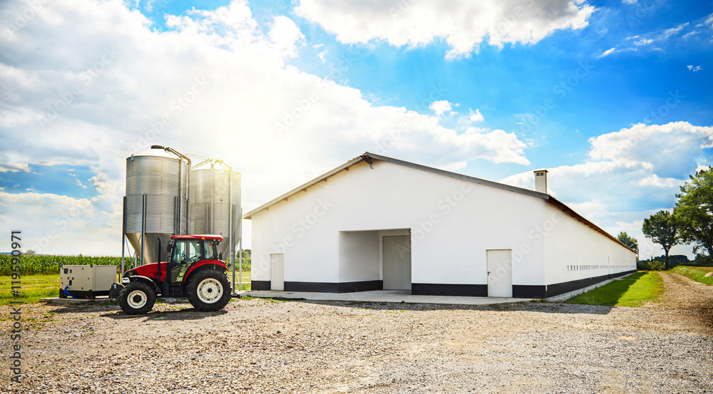 Barn building and modern machinery.