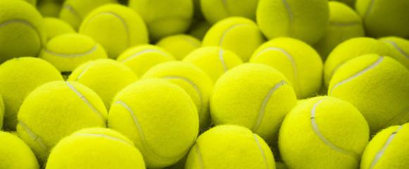 Fototapeta Lots of vibrant tennis balls