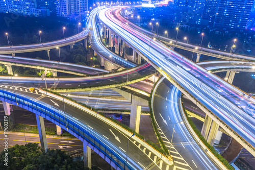 Photo crowded cars driving at flyover,long exposure.